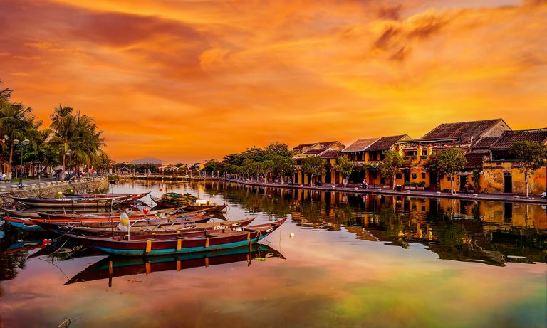 Historic town of Hoi An on the river at sunset